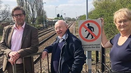 Cllr James Palmer (left) at Whittlesey rail station: he's promised that if he becomes mayor under de