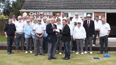 Commercial director of Metalcraft, Martin Lawrence, handed over a cheque for £100 to Chatteris Town