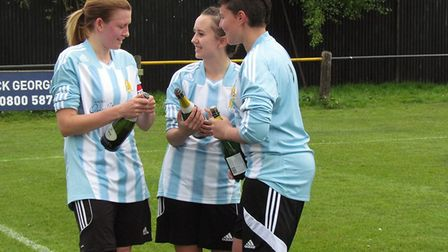 Jade Pointer, Sydney Davis and Emma Frost celebrate March Town's title win.
