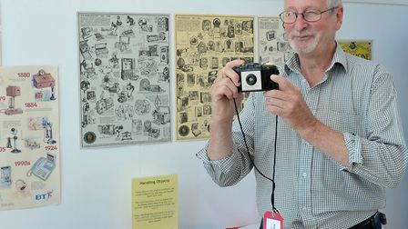 Museum of Technology Throckenholt, Trevor Cass with an old camera from the display. Picture: Steve W