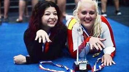 Gold medals for Affinity Cheer and Dance coaches Nikki and Paige.