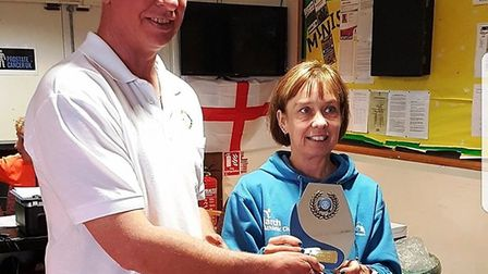 March AC runner Geraldin Larham collects her prize for finishing in second in the ladies category at