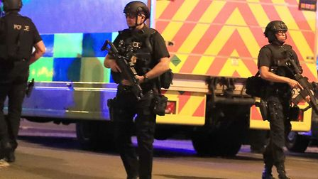 Armed police at Manchester Arena after an explosion at the venue during an Ariana Grande gig. PRESS