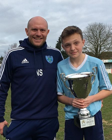 Nigel Smith pictured with his son Archie has been nominated as Sporting Hero in the Ely Hero Awards