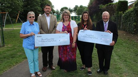 HAGS area manager Helen Sephton-Pike (second from right) presents £125 each to Benwick Scouts and Be