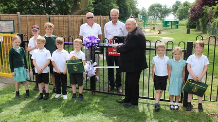 Cllr Peter Murphy (right) cuts the ribbon to officially open Benwick Play Park with primary school c