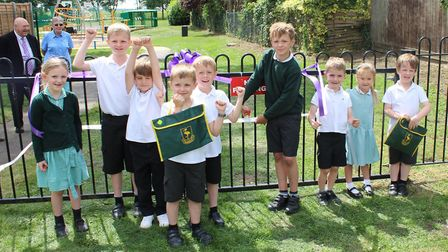 Benwick Primary School pupils are invited to officially cut a ribbon.