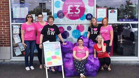 Slimming World Fenland groups donate clothes they have shrunk out of to Cancer Research UK PHOTO: Sl