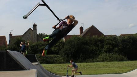 Chatteris skatepark opens - a scooter fan enjoys a ride on the new ramp.