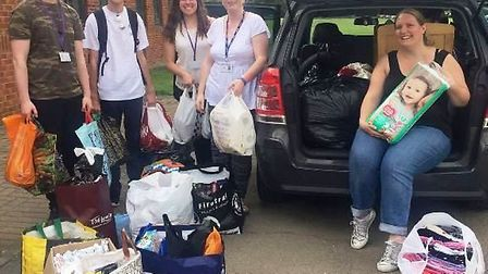 Good samaritan Katrina takes haul of donations to families effected by Grenfell Tower fire.