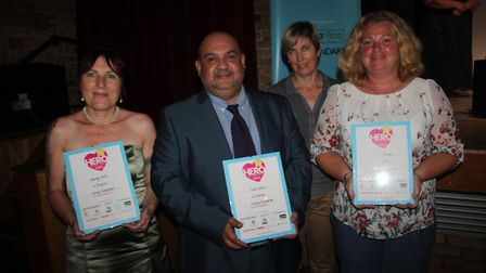 Caring companion: From left: Wendy Halls, Sule Salim and Shellie Jackson with representative from sp