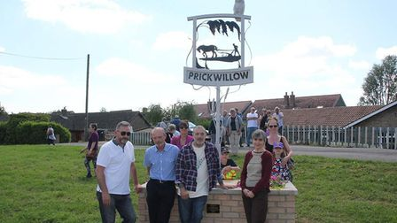 A new sign unveiled in Prickwillow. From left: Mark Morley, Ed Rice, Peter Baker and Prof Ottoline L