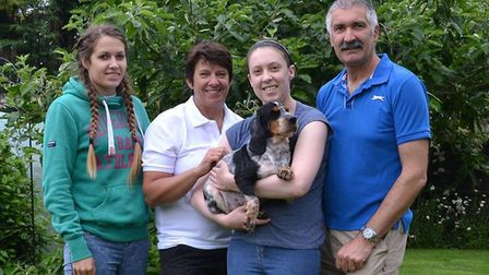 Wanda the cocker spaniel with her new forever family - the Arnolds from March