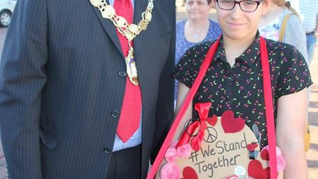 Vigil on Ely Market Place. Ely mayor Councillor Richard Hobbs with one of those selling the speciall