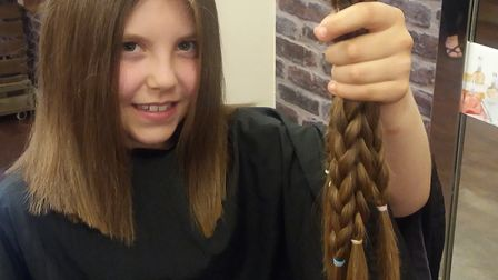 Maisie shows off her hait that she will donate to the Princess Trust.