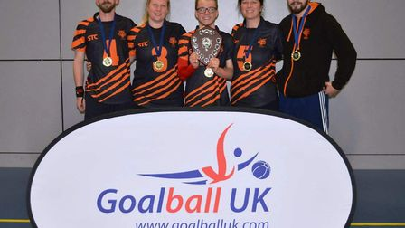 Dan Roper (first right) and Laura Perry (second left) with Fen Tigers players Dom Roper, Joe Roper a