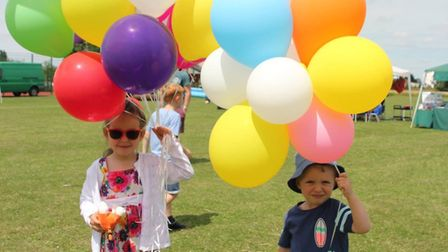 Two young helpers at Little Thetford Feast add splashes of colour and help to raise money for the de