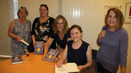 Natasha Pulley (second right) signed copies of her latest novel, 'The Bedlam Stacks,' at Ely Library