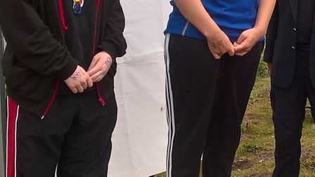 Julia Yeates on the podium after winning gold at the East Region Open Water Swimming Championships.