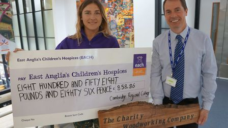 Cambridge Regional College lecturer Mark Piller hands over a cheque to Polly West from East Anglia's