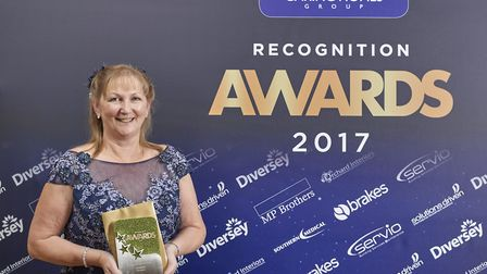 Liz Smith, service manager at The Gables, Littleport, with her 'Registered Nurse of the Year' award.