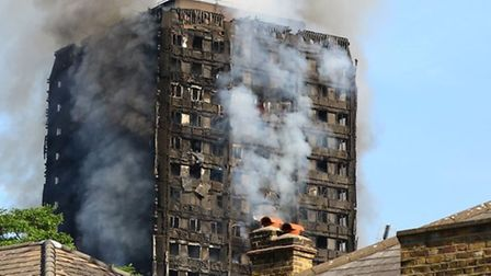 Smoke billows from a fire that has engulfed the Grenfell Tower in west London (Picture: Rick Findler