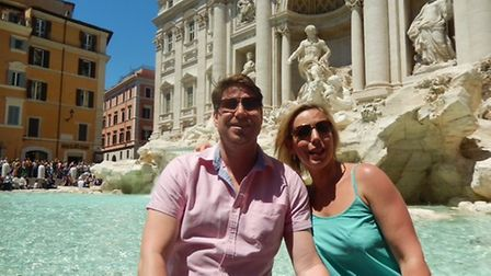 Dean and Lydia Chandler on holiday before they lost the pounds. Picture: LYDIA CHANDLER