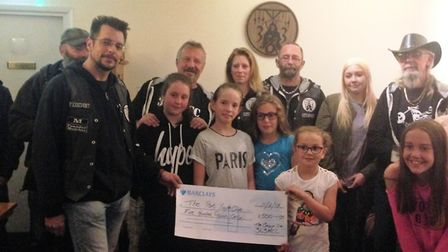 Children from the Port youth club and organiser Joanne Coe, presented with a cheque by Littleport 36