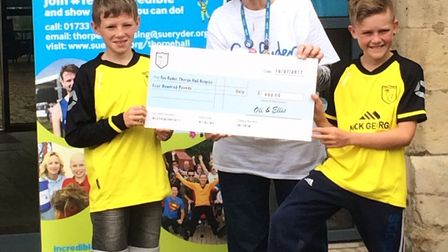 Football talents Oliver and Ellis Frances raised £400 for the Sue Ryder Thorpe Hall Hospice by donat
