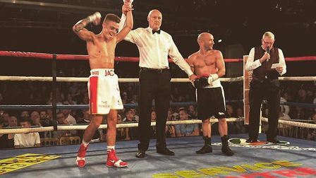 Jack Smith celebrates after easing to an impressive points victory over Gary Reeve (right) in Norwic