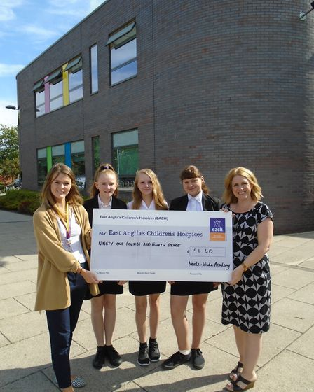 Neale Wade Academy year 7 students present a cheque to East Anglian Children's Hospice. (1) L-R: Gr