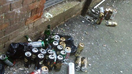 Empty cans of lager and cider discarded in a Wisbech alleyway.