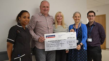 Michelle Marriner, Mark and Kim Cross, Claire Chisenga and Dr McAdam at the cheque presentation.