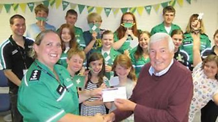 Mike Bentley, from the Rotary Club of Ely, presenting the cheque to Kate Cattani, unit manager for t
