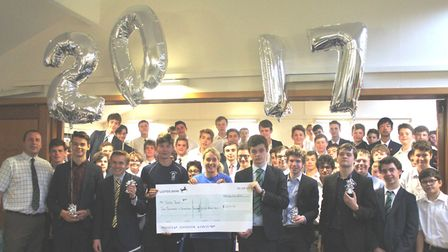 Tom's Trust cheque presented to the charity by students at King's Ely