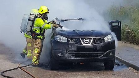 Crews work to control the blaze on the A120 last weekend. Picture: ESSEX COUNTY FIRE & RESCUE SERVIC