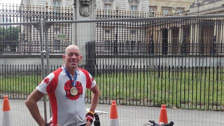 Wayne Harrod, of iselham, compeltes a charity bike ride in around five horus and seven minutes to ra
