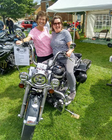 Whittlesey Show on The Green - visitors with one of the exhibits, a Harley Davidson