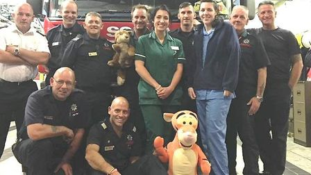 Amical Vet nurses train March fire fighters to help animals in the event of a fire. Tigger assists i