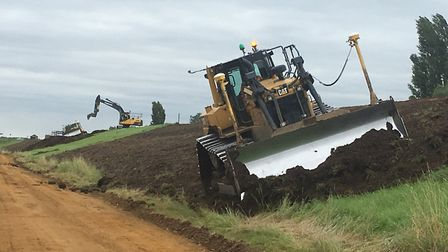 Work has begun to raise the flood banks at the Ouse Washes. Photo: MICK GEORGE