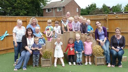 Beaupre Under 5s Centre has been nominated for an outdoor play award. Seen here are staff with child