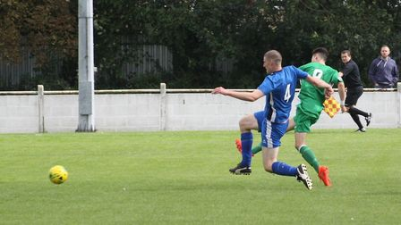 Matty Allan fires in Soham's second goal in their 3-2 FA Cup win over Cogenhoe United. Photo: ANDY B