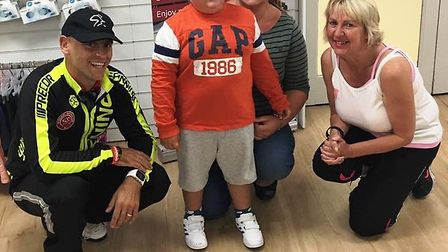 George Hall (5) and mum Susie (centre) meet PCSO Sue Clarke (right) and Spinning instructor Wayne Ma