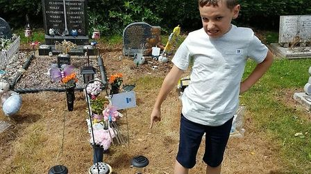 Connor Saunders was upset when he saw the state of his baby sister Olivia's grave at Eastwood Cemete