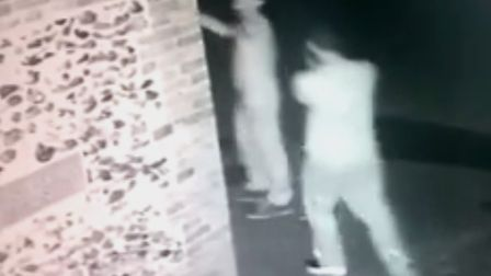 The CCTV footage shows two men reaching to the top of the building in New Street, Snailwell.