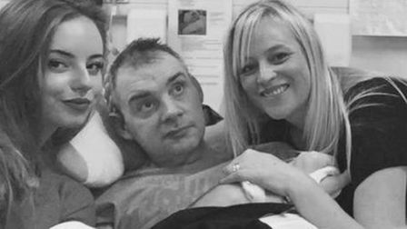 Simon Dobbin, pictured with his daughter Emily and wife Nicole.