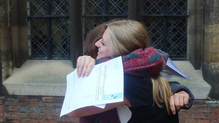 Students celebrate receiving their A-Level results at King's Ely.