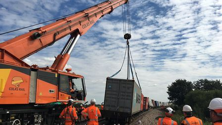 Ely derailment - cranes get to work removing the 11 wagons derailed in Monday's accident