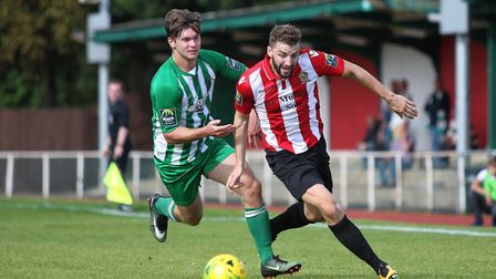 Brad Warner and Daniel Buddle of Soham challenge for the ball during Hornchurch's 3-0 win. Photo: GE