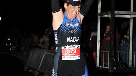 Nadia Baker crosses the line after completing the Ironman Wales endurance challenge earlier this mon